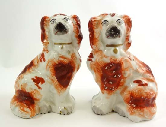 A pair of Victorian Staffordshire Spaniels decorated in