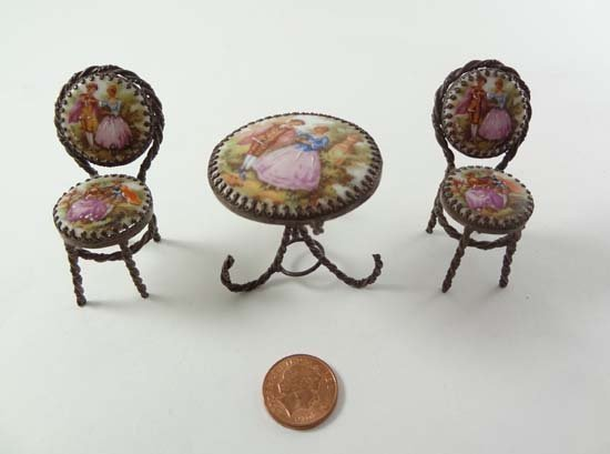 A Limoges porcelain miniature table and 2 chairs, havin