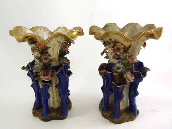 An early 19thC French porcelain pair of vases by Jacob