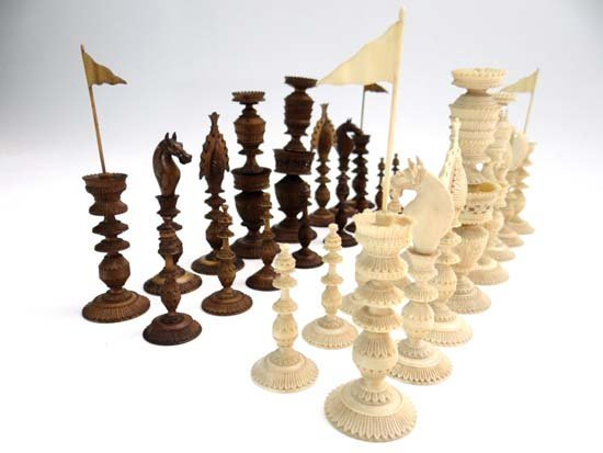 A fine set of 19thC ivory and stained ivory elaborately