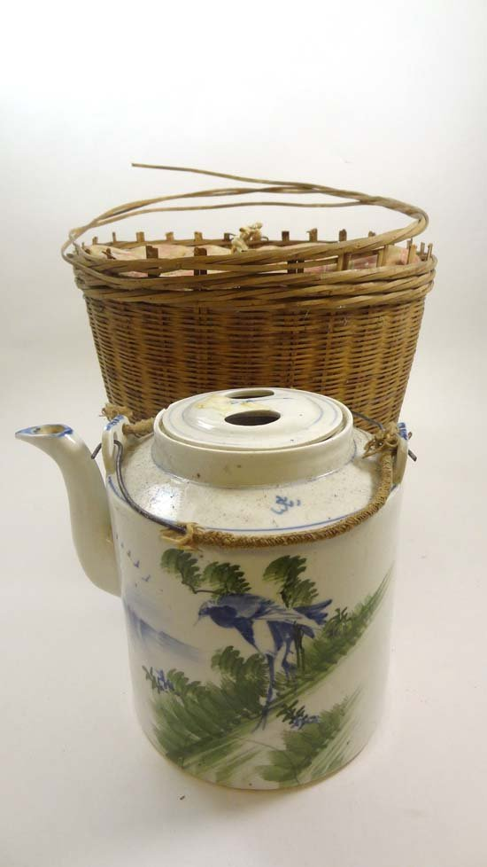 An early 20thC Oriental swing handle lidded teapot with