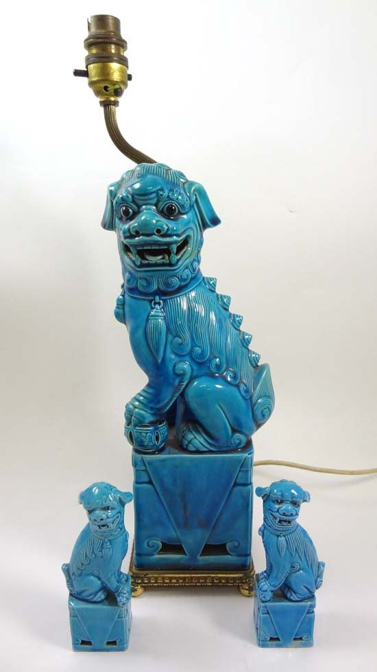 Turquoise glazed dog of fo, comprising a tall figure mo