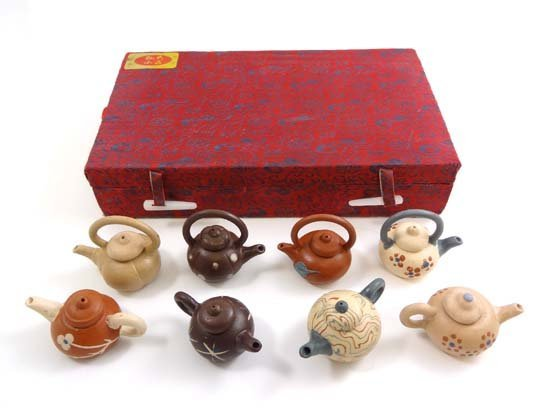 A box collection of 8 miniature Oriental teapots and co