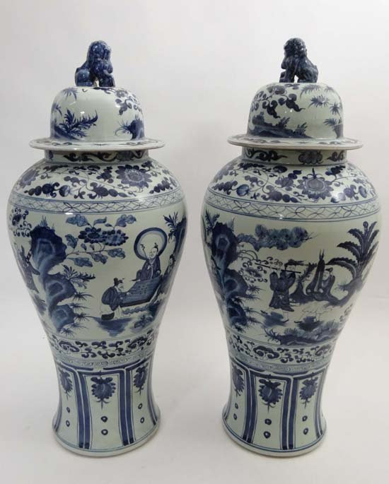 A tall pair of Chinese baluster shaped jars with domed