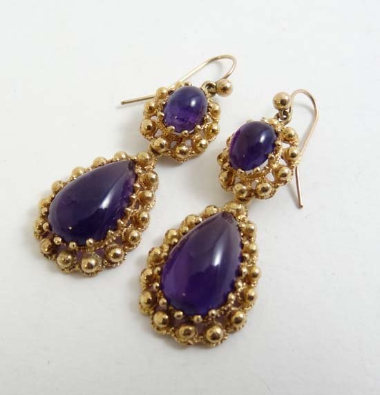 A pair of gilt metal drop earrings set with amethyst