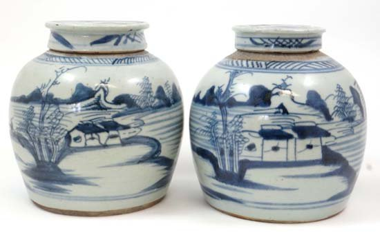 A pair of Oriental blue and white Ginger Jars having fl