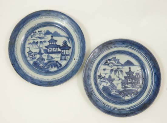 A pair of 19thC Chinese hand painted plates with figure