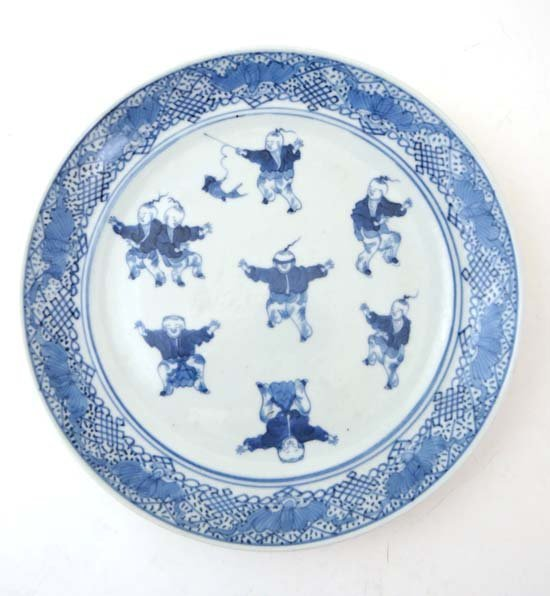 A 19thC Chinese blue and white plate deciding children