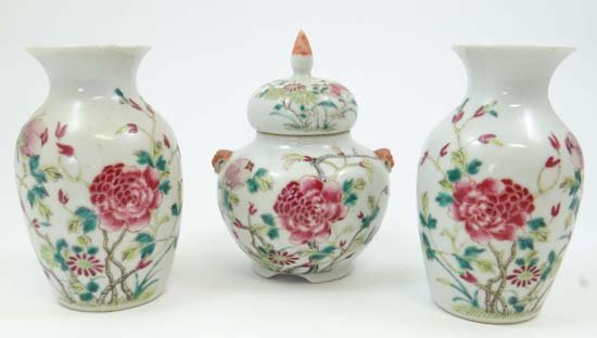 A Pair of Chinese Famille rose baluster shaped vases to
