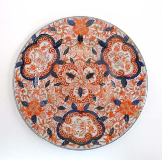 An Oriental ( kutani ? ) plate with gild rust and blue