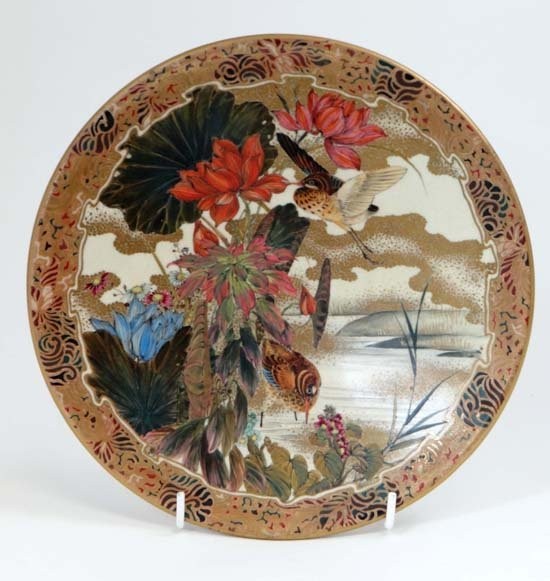 A Japanese Satsuma style polychrome and gilt plate with