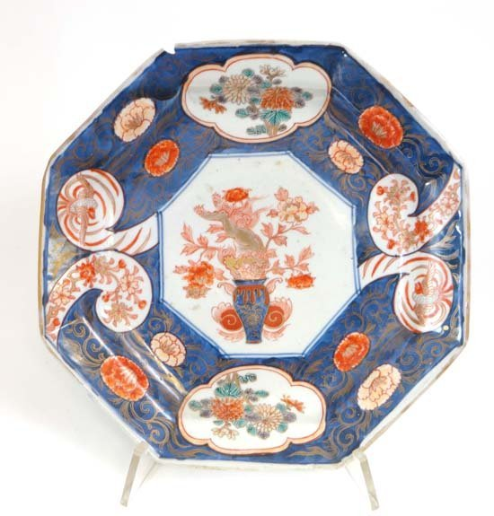 A Japanese Imari style octagonal plate with bird, flora