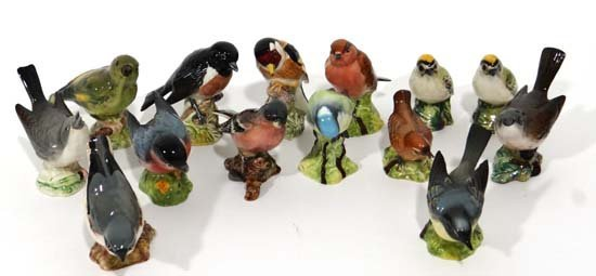 A collection of Beswick bird figures comprising Nuthatc