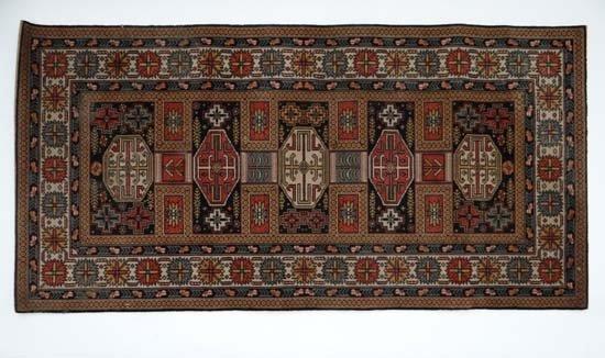 Rug / Carpet : a Persian close pile rug with 5