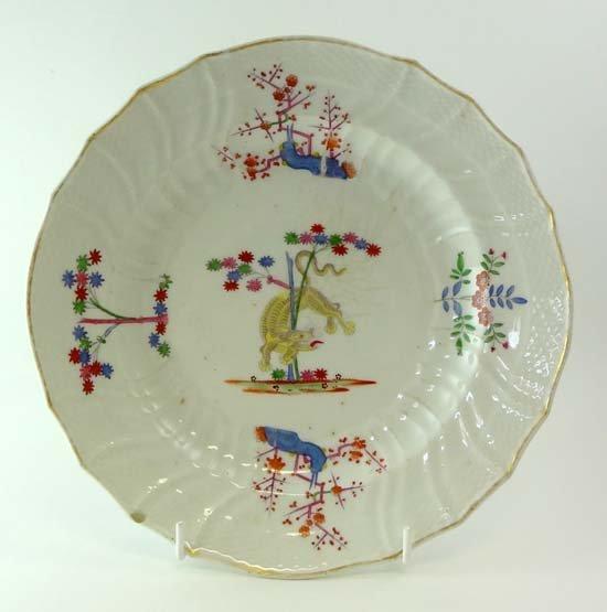 An 18thC Chinese porcelain polychrome plate having flut