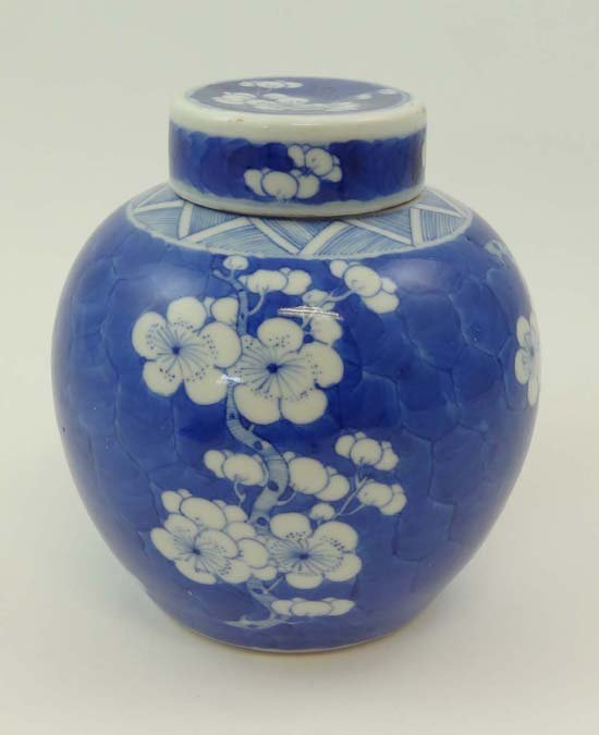 A Chinese covered ginger jar of globular shape with cir