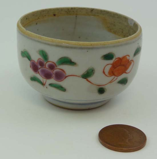 An 18thC Chinese pottery tea bowl painted in polychrome