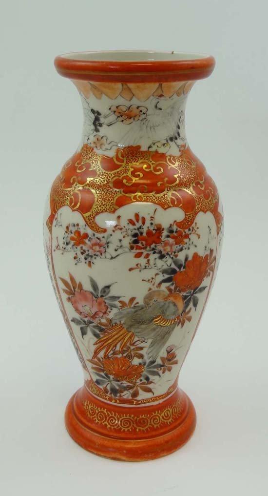 A Japanese Kutani vase of baluster shape decorated in t