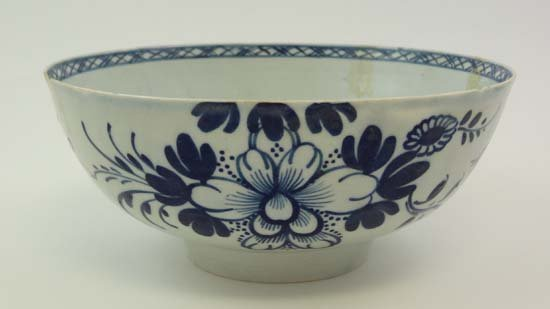 An 18thC pearlware pottery bowl decorated with exotic b