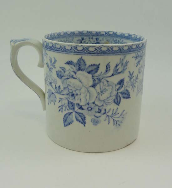 A 19thC blue and white transfer printed mug decorated w
