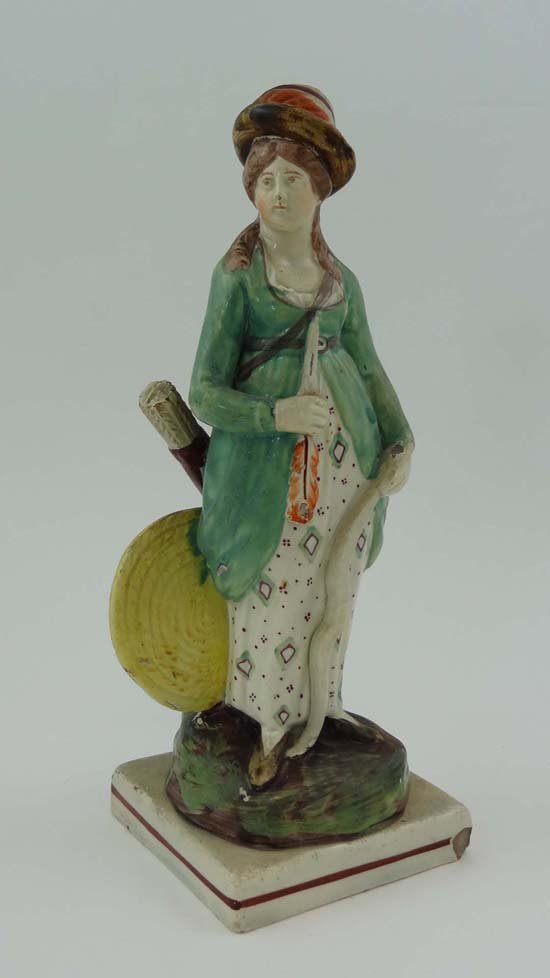An early 19thC Staffordshire pearlware pottery figure d