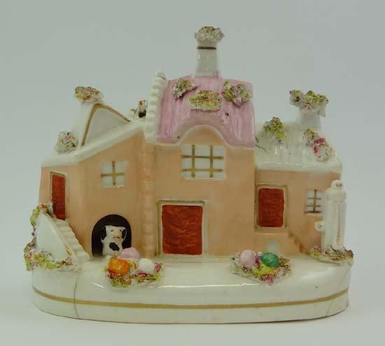 An unusual 19thC Staffordshire porcelain Cottage, havin