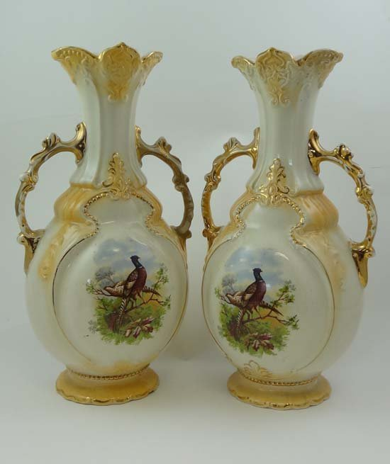 A pair of Victorian Staffordshire two handled vases dec