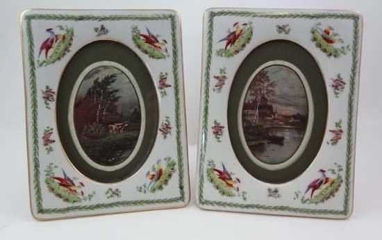 A pair of early to mid 20thC porcelain photograph frame