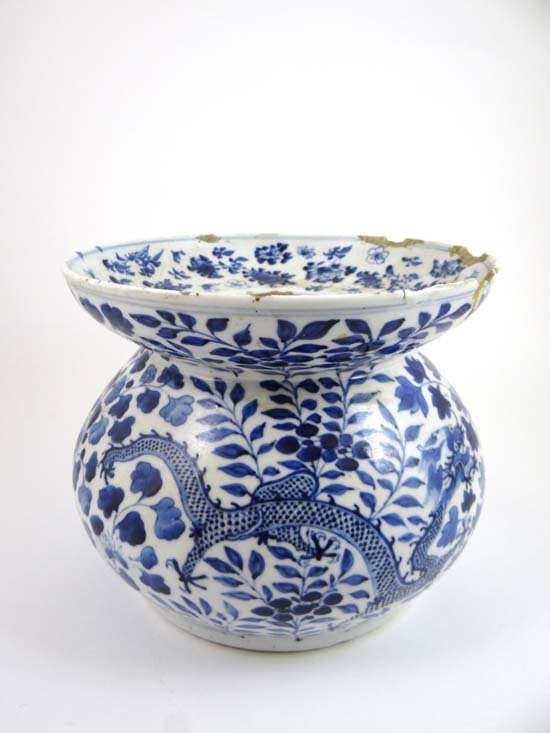 An 18thC blue and white Chinese Cspidor decorated four-