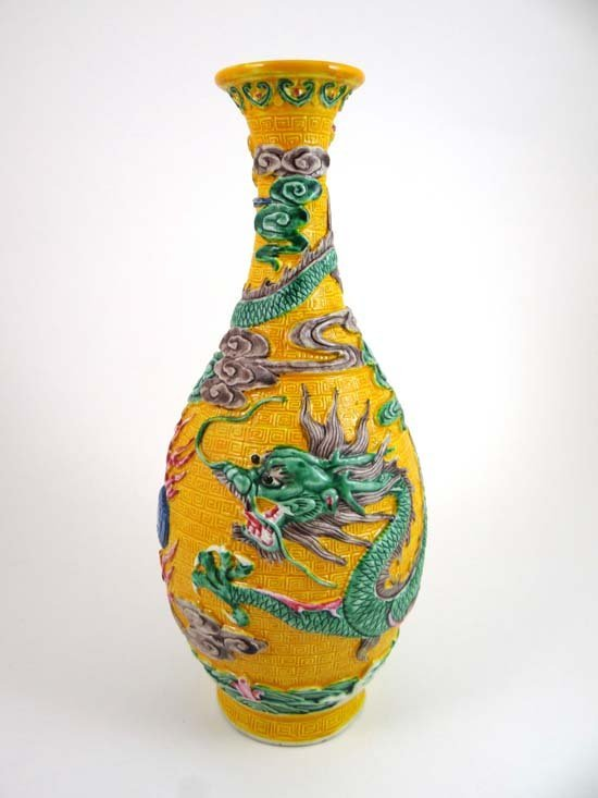 A Chinese Qianlong tall vase decorated in egg and spina