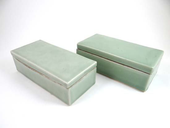 A pair of 18th / 19thC Oriental celadon glazed rectangu
