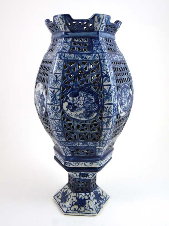 A Chinese blue and white hexagonal reticulated lamp on