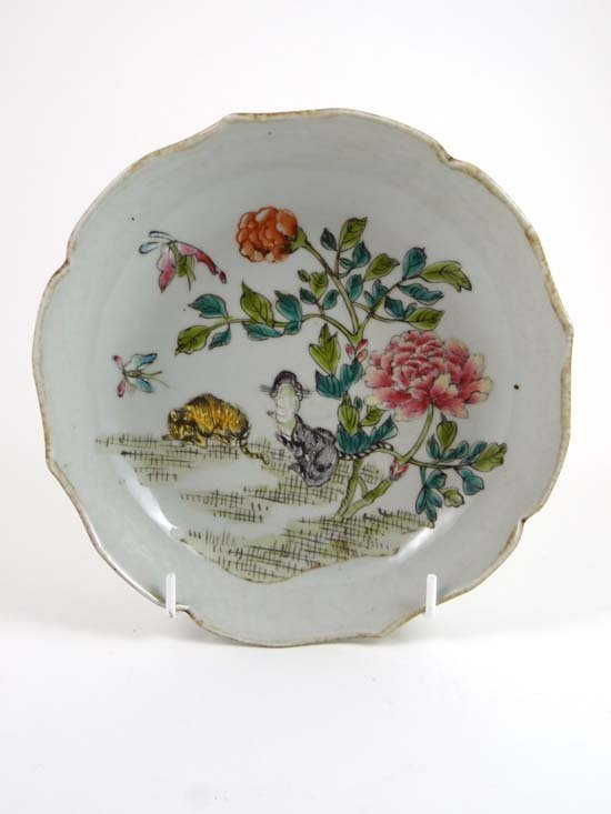 An 18thC polychrome bowl of lotus shape painted with Ca
