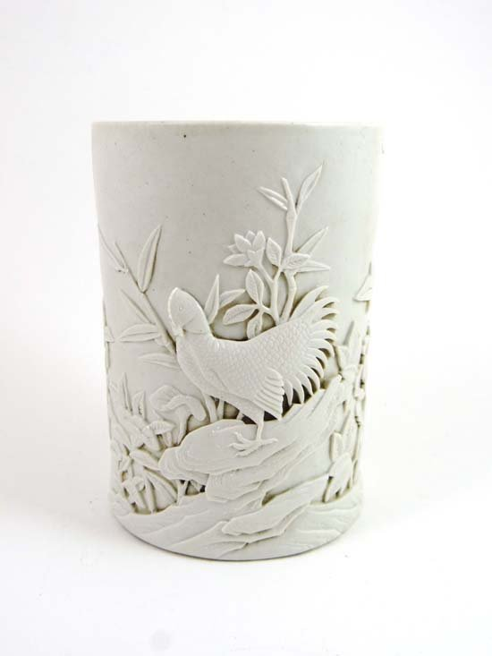 A 19thC Qing dynasty Chinese white glazed brush pot dec