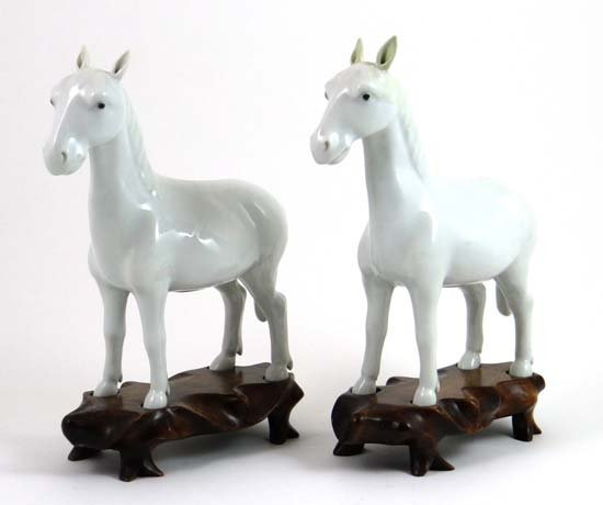 A pair of 19thC Chinese Blanc de Chen figures on horses