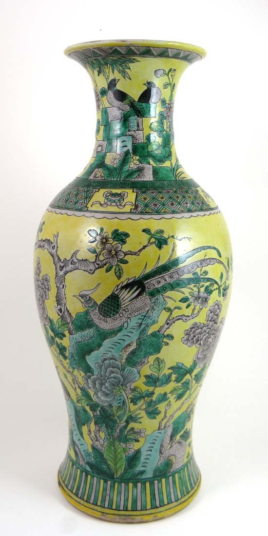 An 18thC Chinese yellow and spinach green baluster shap