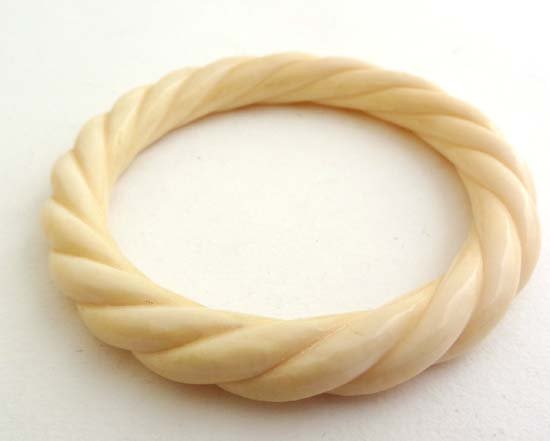 An early 20thC ivory bracelet with ropetwist decoration