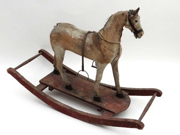 Rocking Horse : A 19thC  rocking horse on pull along se
