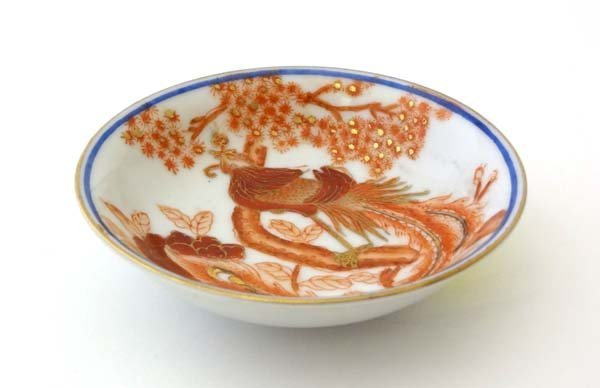 Kutani : An early 20thC signed small dish with image of