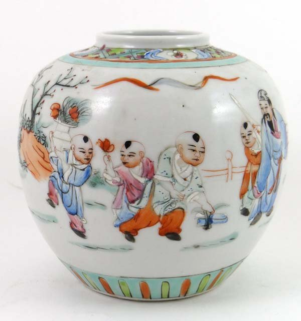 A Japanese ginger jar with handpainted scenes of boys