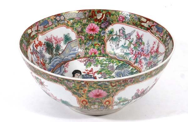 A large Oriental bowl decorated to interior and