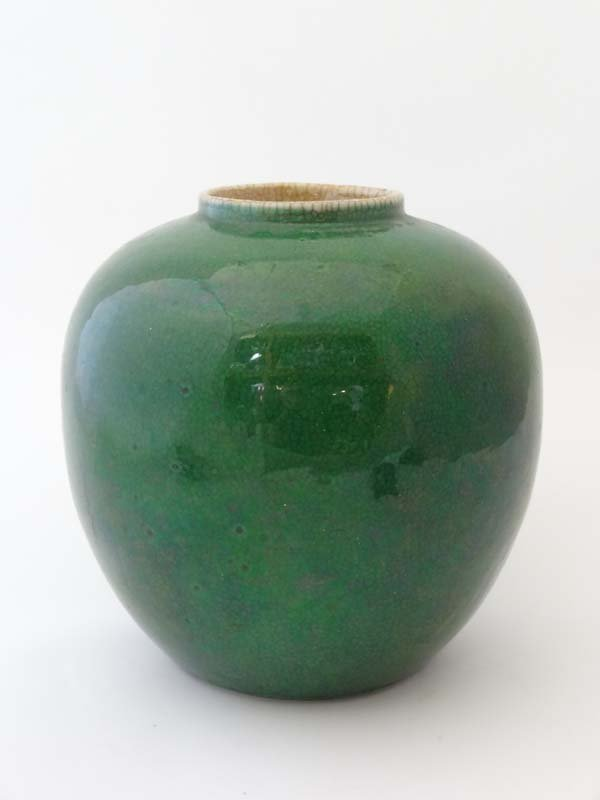 A Guangxu period Chinese green pottery vase of ovoid