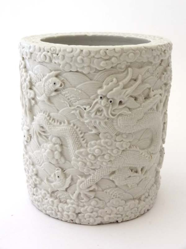 An Oriental late 19th/ early 20thC blanc de Chine pot,