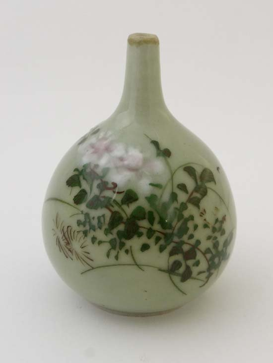 An Oriental vase decorated with foliate design in low