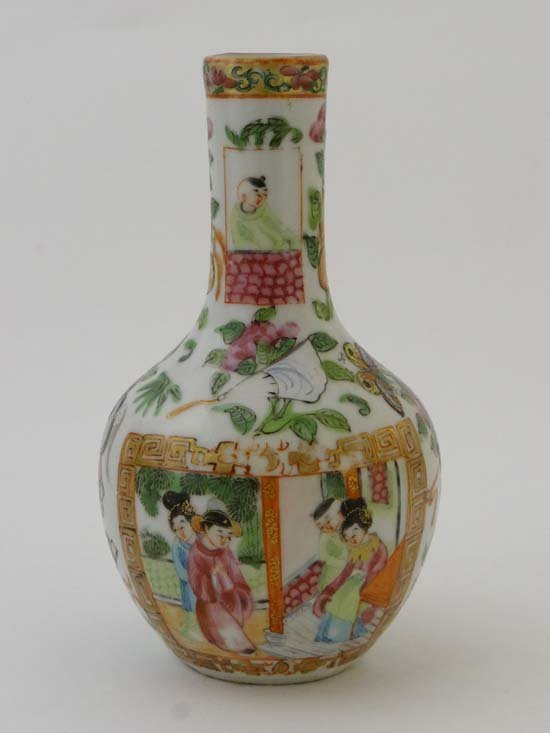 A Chinese famille rose vase decorated with scene with
