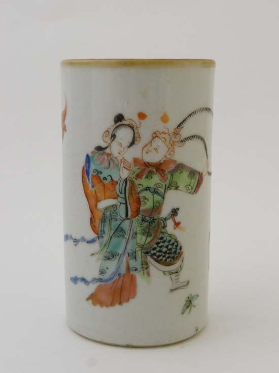 A Chinese porcelain brush pot of tapered form decorated