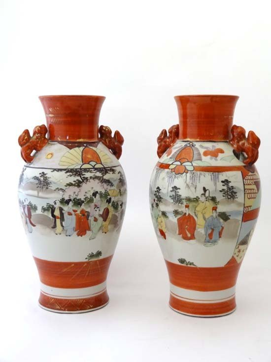 A Japanese porcelain pair of vases decorated with iron