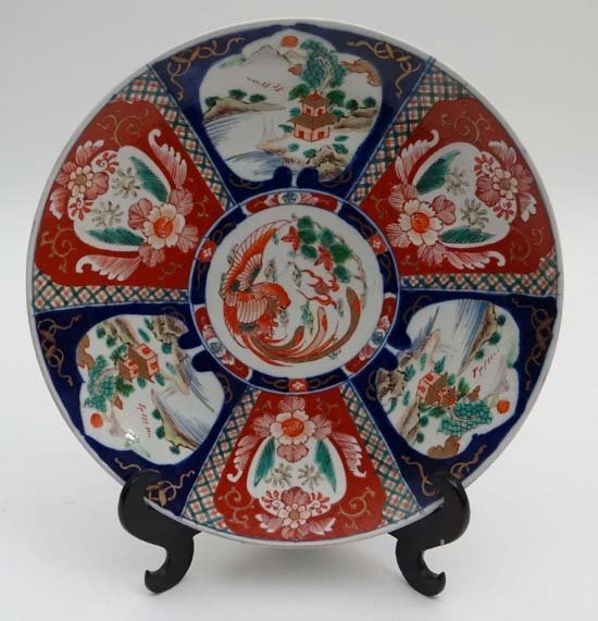 An Imari charger decorated in traditional palette with