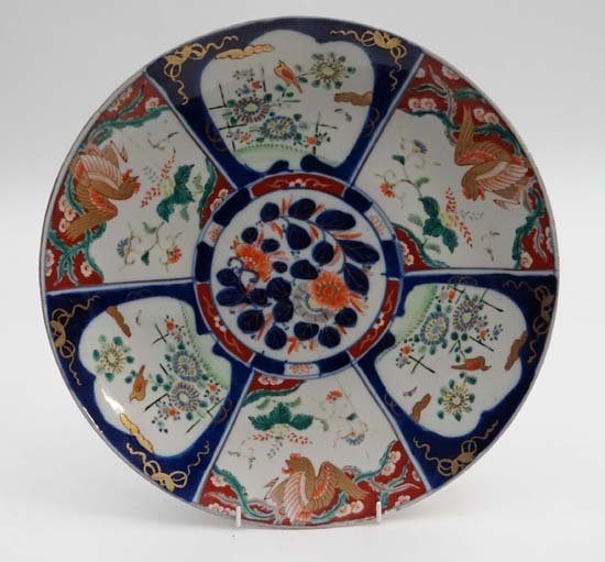 A Japanese signed Imari charger with six panels within,