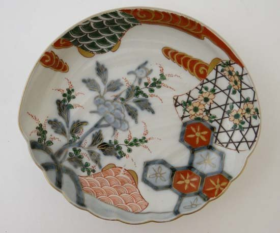 An Japanese bowl decorated in polychrome with a central